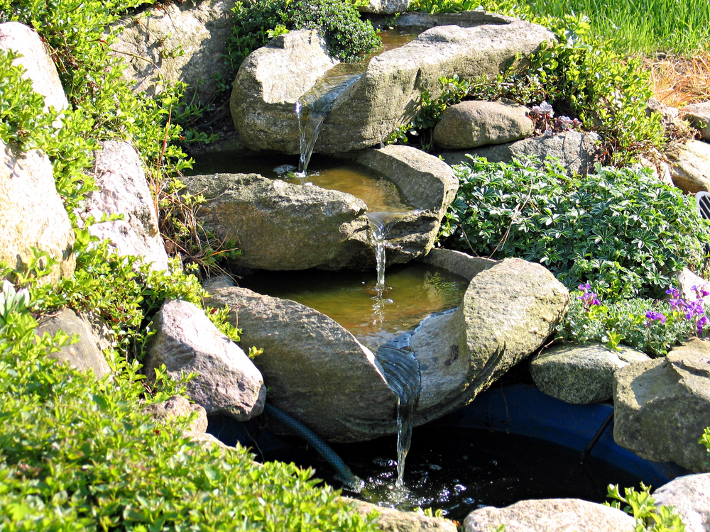 How to build an outdoor waterfall 6 simple steps for Garden pool fountains