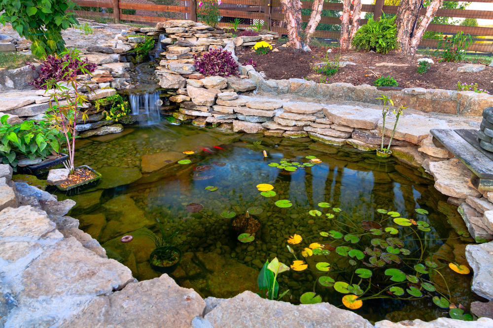 How to build an outdoor waterfall 6 simple steps for Simple koi pond