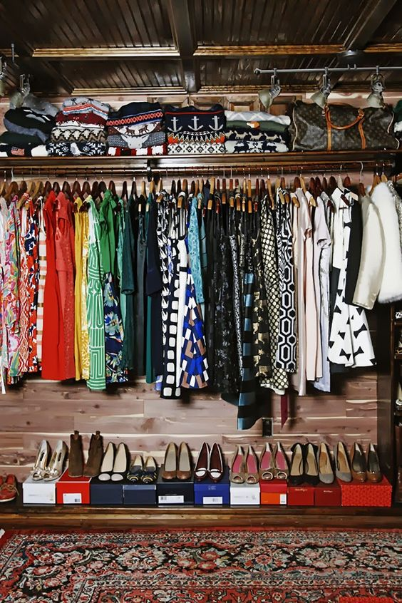 organising your clothes by color is a useful way of making your closet more easily accessible