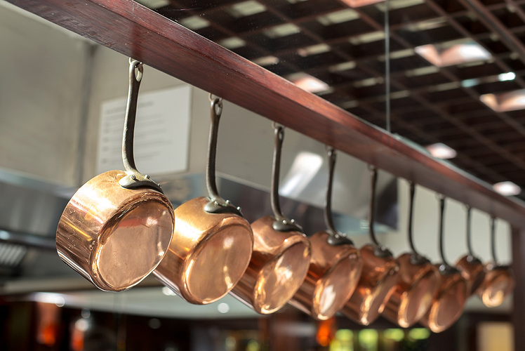 Use an overhead rack to store your pots and pans